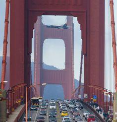 jet goes over golden gate bridge