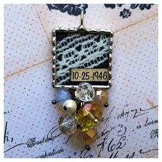 This has to be one of my favorite custom bouquet charms. Vintage Lace from her grandmas wedding dress with wedding date. This is going to look beautiful hanging from her bouquet. http://justcharmsandprettythings.com/shop Hand soldered charm.