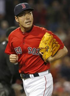 BOSTON, MA - MAY 30: Pitcher Koji Uehara #19 of the Boston Red Sox runs off the field after the ninth inning of the game against the Tampa Bay Rays at Fenway Park on May 30, 2014 in Boston, Massachusetts. (Photo by Winslow Townson/Getty Images)