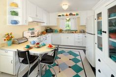 Beautiful 40s-style kitchen reno. Plenty of closed storage with just enough open shelving to show off pretty things.