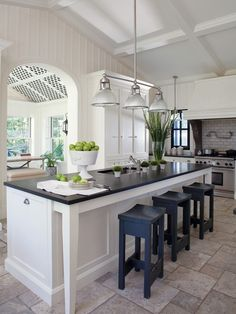 Love Love Love. Note:white subway tile and a hanging pendant light from one pole - we can do this! Black granite looks great next to white cabinets and island.