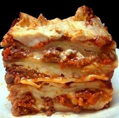 Authentic Lasagna Bolognese. The meatiest, creamiest, cheesy lasagna you'll ever have.