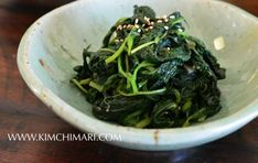 Perilla Kkaetnip Namul (깻잎나물) is the green color of the samsaek namul.  Spinach or Dropwart ( minari 미나리) is also used for the green namul.  Full of special sesame and pungent flavor of the leaf it is a favorite namul in Korea.  | Kimchimari.com