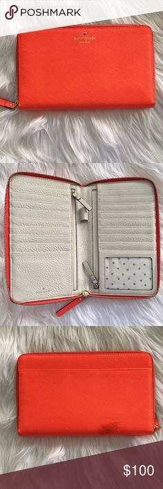 Kate Spade Neon Orange Travel Wallet Condition: used. Normal wear. Spot on back of wallet. I do not know what it is from. Small spot on front.  • NO TRADES kate spade Bags Wallets