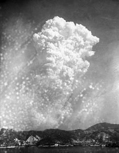 The mushroom cloud over Hiroshima as seen from the Japanese naval arsenal in Kure, 06 August 1945/Masami Oka