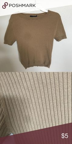 Tan ribbed crop top from forever 21 Worn a few times, in good condition. I see there's a gray spot on the shirt but it's on a lot of my photos I have a problem with my back camera. No stains on any of my clothing. Forever 21 Tops Crop Tops