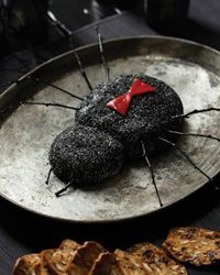 Black Widow Goat Cheese Log Recipe // More Goat Cheese Recipes: http://www.foodandwine.com/slideshows/goat-cheese #halloween #foodandwine