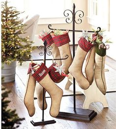 Tabletop Stocking Holder - $39.00»  Here's another unique stocking holder. These could be left out all year or used for other things, like holding wreaths. The wrought iron look would fit in well with all kinds of decor.