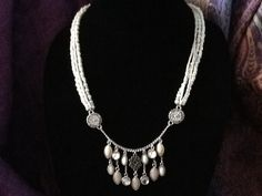 Multi-pearl necklace with fringe of stringed set stones, silver accents. $35.00, free ship