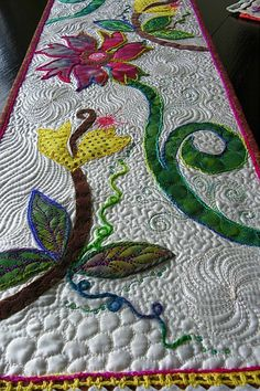 Great free motion quilting and couching. The cotton sateen adds a nice sheen. This must be divine in person.