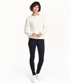 Dark blue. Treggings in superstretch twill with a regular waist, a mock pocket at back, and visible side zip.