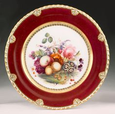 A Rockingham plate circa 1826-30 the rim with 'anthemion and gadroon' moulding, finely painted with a complex grouping of fruit and flowers, probably by Thomas Steel, within a wide claret border,