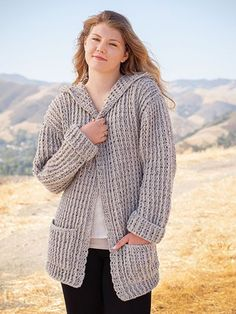 "Wrap yourself in casual style with this versatile hooded cardigan! Includes sizes S (M, L, XL, 2XL, 3XL). Sample made using 9 (10, 12, 13, 14, 15) skeins of Plymouth Encore worsted-weight yarn. Finished measurements are: Bust: 38"" S (40"" M,..."