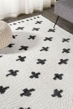 Inspired by vintage Moroccan rugs, our modern geometric rug has a soft, low shag pile. The all-over cross pattern is woven in black on an ivory background; our tribal-inspired design recalls traditional handwoven rugs. Add some Bohemian style to your living room, bedroom, or reading nook with this easy-care rug. Cross Patterns, Moroccan Rugs, Geometric Rug, Home Rugs, Reading Nook, Home Decor Trends, Rug Making, Bohemian Style, Color Schemes