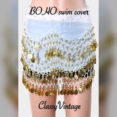 Super fun dance or swim cover Super fun white sheer crepe fabric. Sheer crepe with gold tone coins dangling down.?This ties at side and can be worn over whatever you want. Great for beach and festivals Boutique Swim Coverups