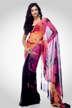 An animal print saree depicted with blocking of colours.Worn with a matching crepe blouse piece.Shop onliine at www.satyapaul.com and visit us at www.facebook.com/SatyaPaulIndia