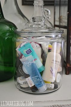 Put samples of shampoo, lotion, conditioner, & other toiletries in a glass container & put in guest bedroom when you have overnight guests s...