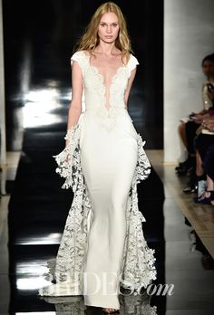Brides.com: . Silk georgette wedding dress with plunging neckline and re-embroidered lace bodice, Reem Acra