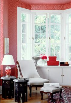 wallpaper + furniture style + rug.  well done in red & white.