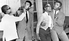 Stevie Wonder, age 13, hangs out with Mohammad Ali, 1963.