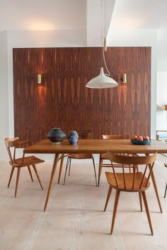 wood paneling in designer loft in berlin, mid century modern furniture,  pottery collection