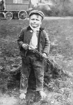 How sad. It's cold enough to be wearing a jacket, and he has no shoes. Gypsy boy. Late 19th Century.