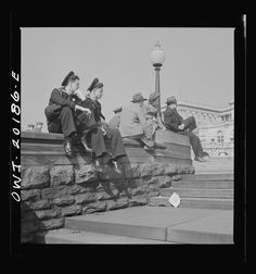 """March, 1943. """"Washington, D.C. Sailors and civilians sitting on the Capitol grounds."""" Bubley, Esther, photographer. Farm Security Administration – Office of War Information Photograph Collection, Library of Congress."""