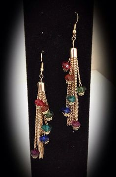 SOLD The Rainbow Connection on Etsy, $17.00 Rainbow color crystal beads on gold tassel dangle earrings