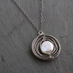 Sterling wrapped white coin pearl necklace.