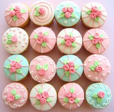 Pastel pink, blue, green, white cupcakes with roses.