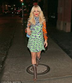 Retro Rita: Miss Ora cut a vintage figure in a bright patterned dress and lace-up ankle bo...