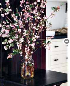 Berry branches are beautiful and vibrant on their own, stacked high in an oversized mason jar. The pinks, greens and browns of the berries, leaves and branches create a playful floral focal point against a dark backdrop.