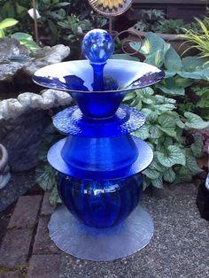 Beautiful cobalt blue glass birdbath for the garden.