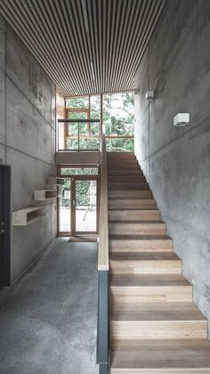 Stairs Inside, raw concrete walls and floors are paired with pine plywood panelling and. Inside, raw concrete walls and floors are paired with pine plywood panelling and bamboo stairs, while slats of timber run across the sloping ceilings. Concrete Stairs, Concrete Houses, Concrete Wood, Concrete Design, Concrete Floors, Wood Stairs, Concrete Bedroom, Timber Staircase, Concrete Facade