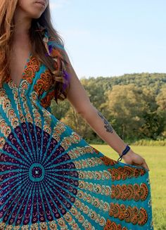 I love this Colorful Bohemian Dress & the lovely feathers in her hair.