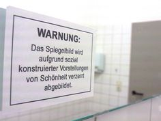 warning on a universety toilet