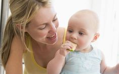 Weaning baby girl eating an apple