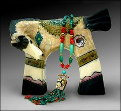 Cathy Wallace Crain, http://www.crainartstudio.com/  A new Raku horse sculpture with a peek of my new jewelry line which will debut in Jan. 2013. I have really been busy creating new work both in clay and metal.