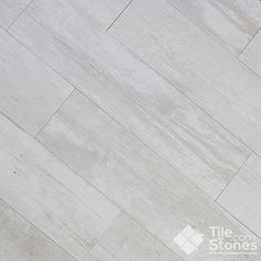 Colonial White Wood Plank Porcelain Tile by Tile-Stones. Use a material which can take a beating with heavy use. Go for a more natural, gray tone. It will brighten the space
