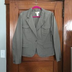 Blazer. Khaki green color Khaki green colored blazer. Relaxed sport jacket. Worn it with a creme colored tank and skinny jeans with flats in the fall. Jackets & Coats Blazers