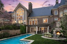 Traditional Exterior of Home with outdoor pizza oven, Trellis, exterior stone floors, Raised beds