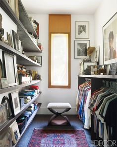 A dressing room filled with art, and a vintage oriental rug