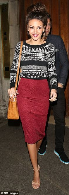 Berry nice! The former soap star's choice of berry pencil skirt perfectly accentuated her ...