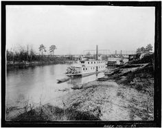 43. MISSISSIPPI, LOWNDES CO. COLUMBUS RAILROAD BRIDGE End of 1st St. S., Columbus, Ms. Copy of photo [1900]. Shows 1878 M&O RR bridge. The steamboat, 'Gopher,' in foreground, was an archeological survey vessel from the Franklin Institute in Philadelphia. Published in Art in Mississippi (1901). Credit: Copied from print in Lowndes Co. Public Library by Sarcone Photography, Columbus, Ms. 1978. - Bridges of the Upper Tombigbee River Valley, Columbus, Lowndes County, MS