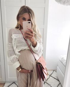 Neutral boho maternity style.