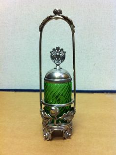 Antique green glass pickle castor.  Decorations are an acorn and oak leaves.