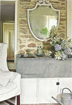 Wonderful Assortment Of Textures  Rough Rock Wall, Smooth Unoiled Soapstone  Sink, Slipcovered Chair, And Dried Flower Arrangement.