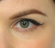 Ginnifer Goodwin. Dewy skin, barely there lips, and a subtle cat eye.