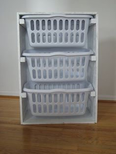Make your own laundry sorter! I love this idea! Especially since the ones at the store won't even hold a full load like this will. I would dress this up by using nicer wood, staining it and using black baskets.