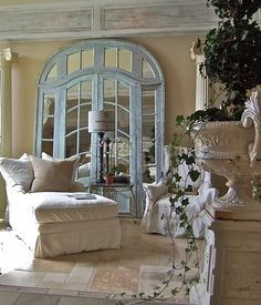 right up my alley........large double mirrored door and surround used as a decorated back drop in a living room....dramatic!